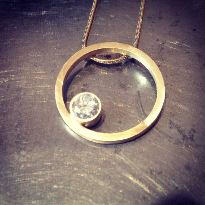 Gold circle necklace with diamond