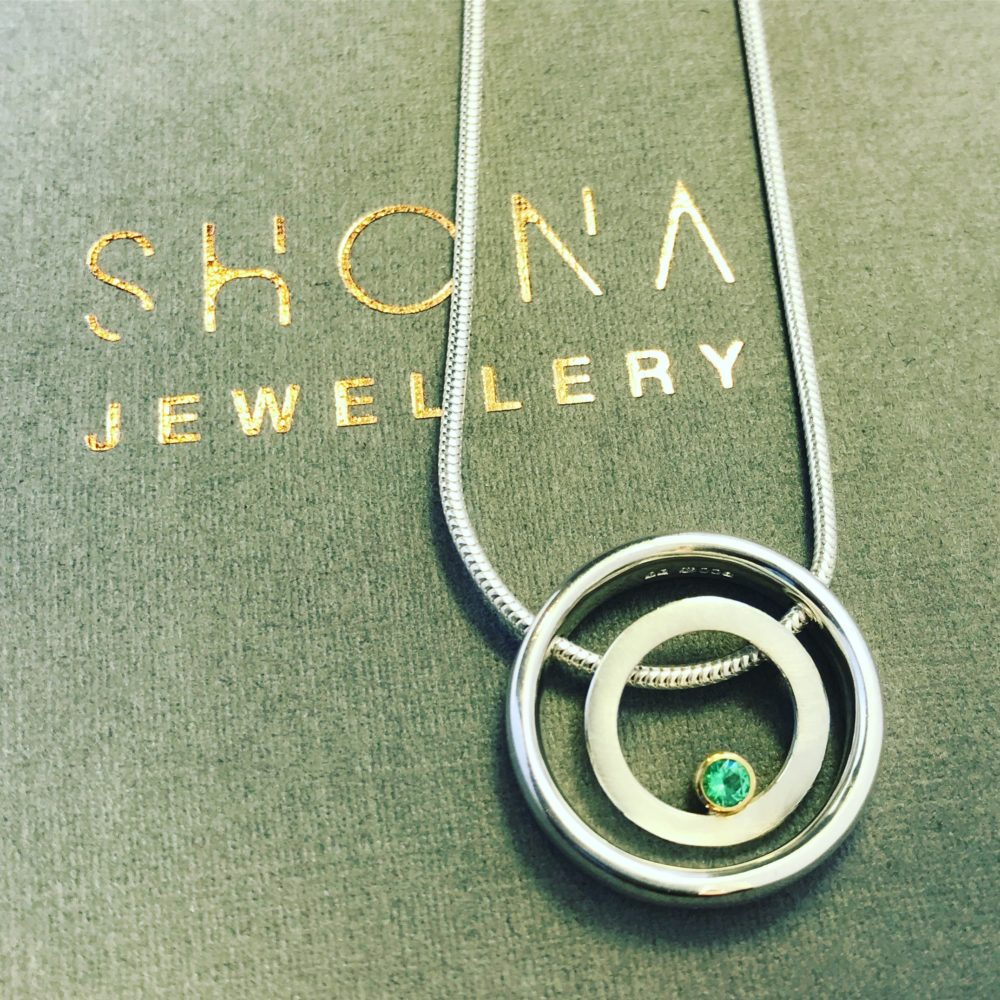 Emerald Halo Necklace On Packaging